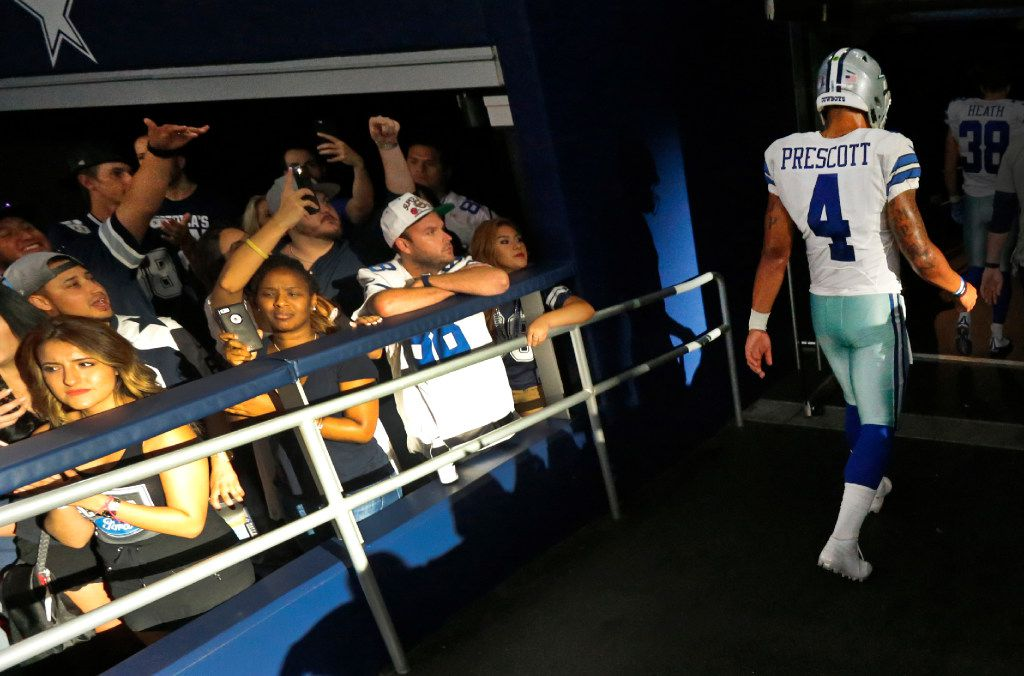 Dallas Cowboys quarterback Dak Prescott (4) walks to the locker room after running out of time on the final drive of Dallas' 20-19 loss during the New York Giants vs. the Dallas Cowboys NFL football game at AT&T Stadium in Arlington, Texas on Sunday, September 11, 2016. (Louis DeLuca/The Dallas Morning News)