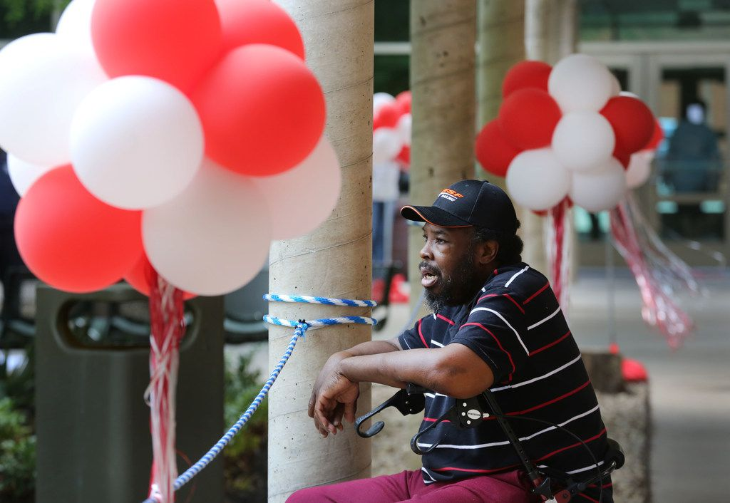 Bridge resident Darryl Bennett watches the festivities from the shade during the ten-year anniversary event at the Bridge Homeless Recovery Center in downtown Dallas, photographed on Monday, May 14, 2018.  (Louis DeLuca/The Dallas Morning News)
