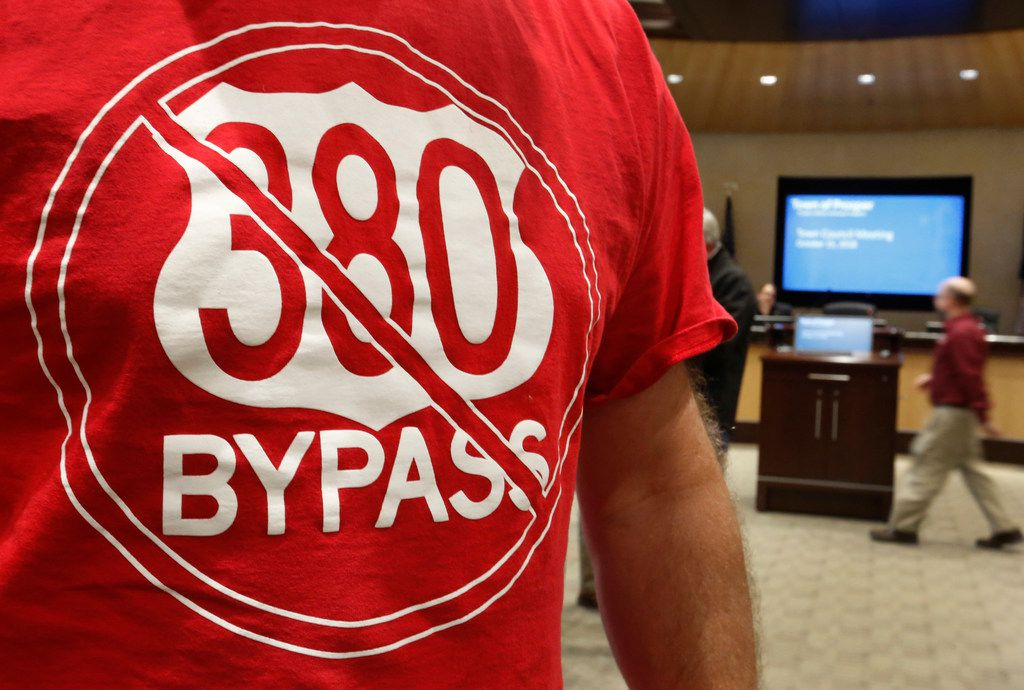 Many Prosper residents wore T-shirts supporting their cause as they crowded into Prosper Town Hall to oppose an option for a U.S. Highway 380 bypass from the Texas Department of Transportation. One proposed freeway option would cut through a corner of the town.