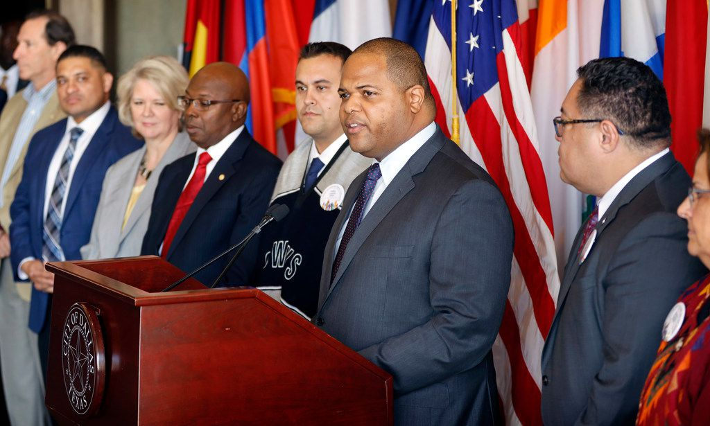 The Dallas City Council along with Mayor Eric Johnson (speaking at podium) passed a budget largely focused on public safety that reduces the property tax rate by one-hundredth of a cent at Dallas City Hall on Wednesday. (Tom Fox/The Dallas Morning News)