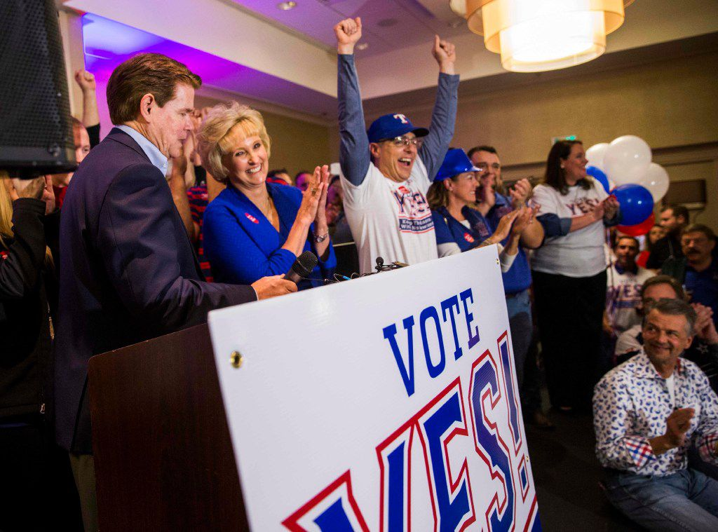 Mayor Jeff Williams (left), wife Karen and other supporters of a proposed new stadium for the Texas Rangers celebrated at the Hilton Arlington after early voting gave them an advantage Tuesday. (Ashley Landis/Staff Photographer)