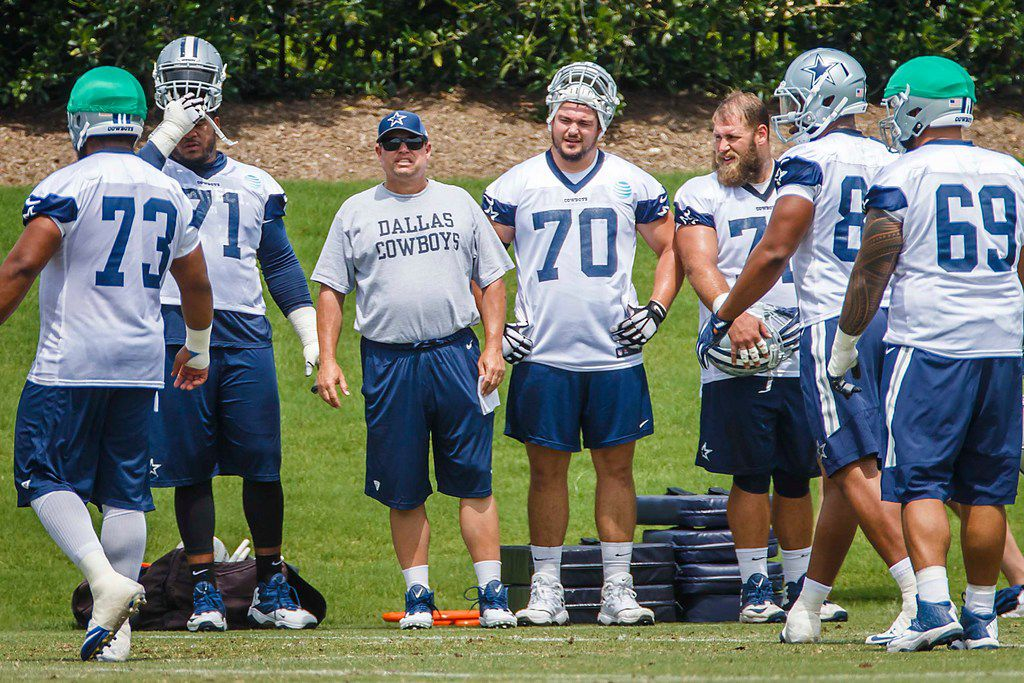 Dallas Cowboys offensive line coach Paul Alexander watches his team workout along side offensive tackle La'el Collins (71) ,offensive guard Zack Martin (70) and center Travis Frederick (72) during the team's minicamp at The Star on Wednesday, June 13, 2018, in Frisco. (Smiley N. Pool/The Dallas Morning News)