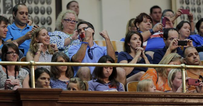 Supporters of new abortion restrictions celebrated in the House gallery Tuesday after the bill's tentative approval.