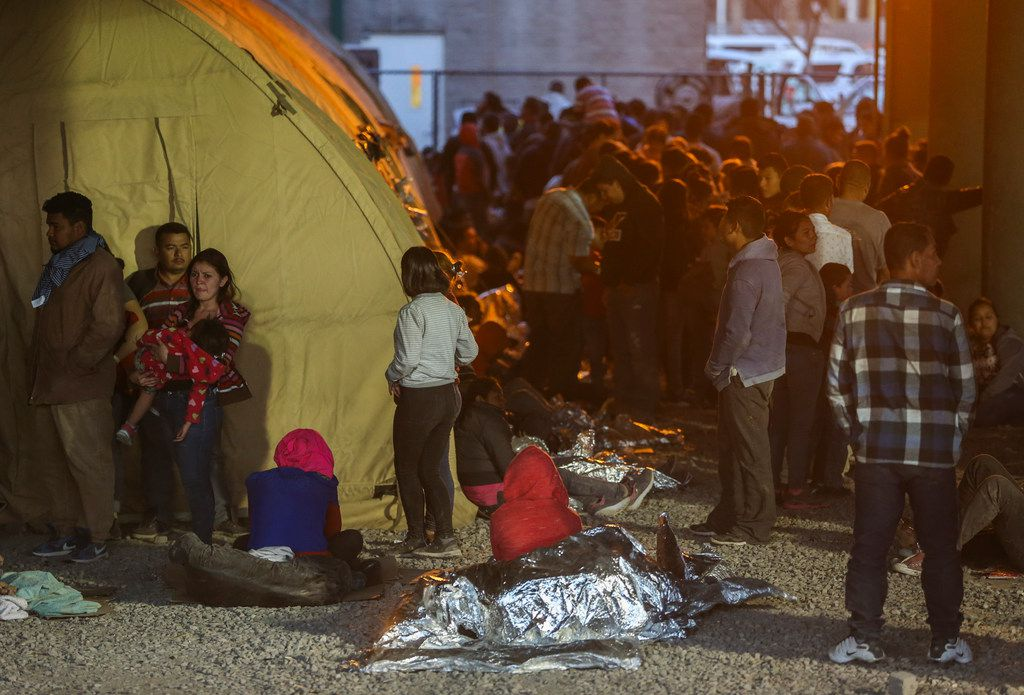 Migrants, including young children and babies, at the U.S. Border Patrol temporary holding area under the Paso Del Norte bridge in El Paso, Texas, on Friday, March 29, 2019. Some migrants were held there for as many as four days and slept outside on gravel, provided only thin Mylar blankets for warmth.