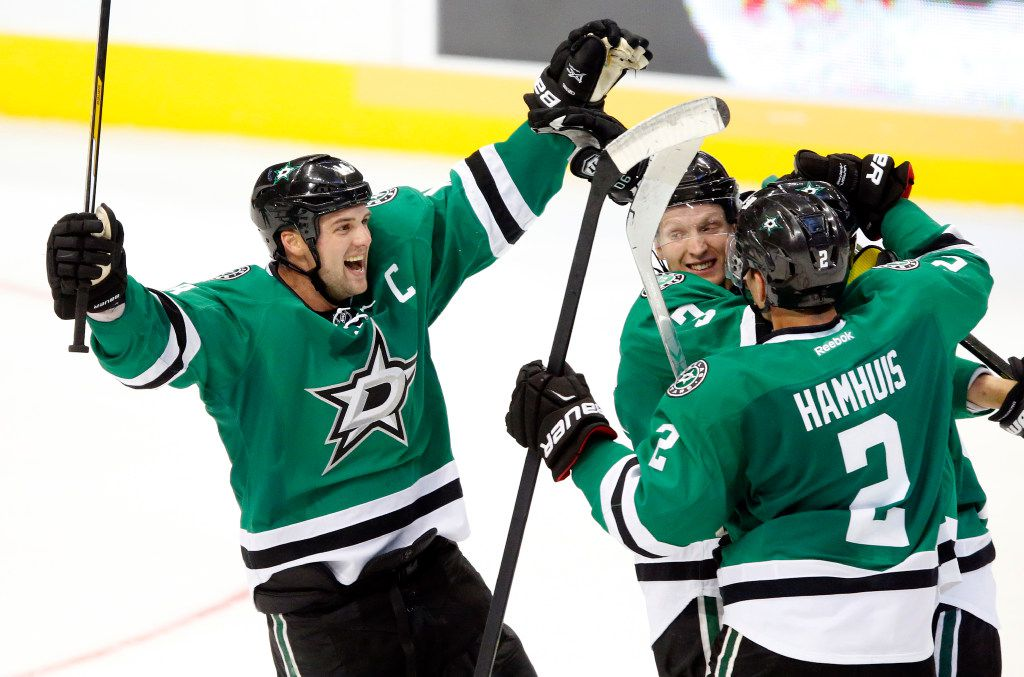 FILE - Dallas Stars left wing Jamie Benn (14) joins a celebration after Jason Spezza's goal against Los Angeles Kings in the third period at American Airlines Center in Dallas on Thursday, Oct. 20, 2016. (Tom Fox/The Dallas Morning News)