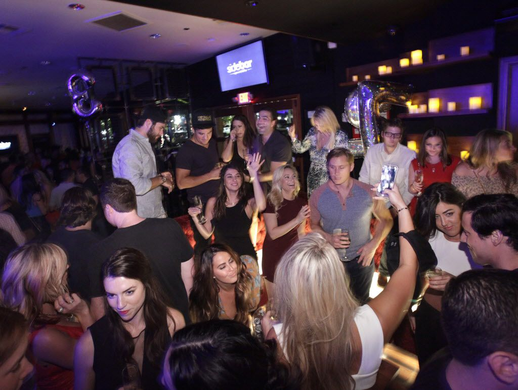 Guests enjoy the drinks and music at Sidebar in Dallas, TX, on Sep. 19, 2015.
