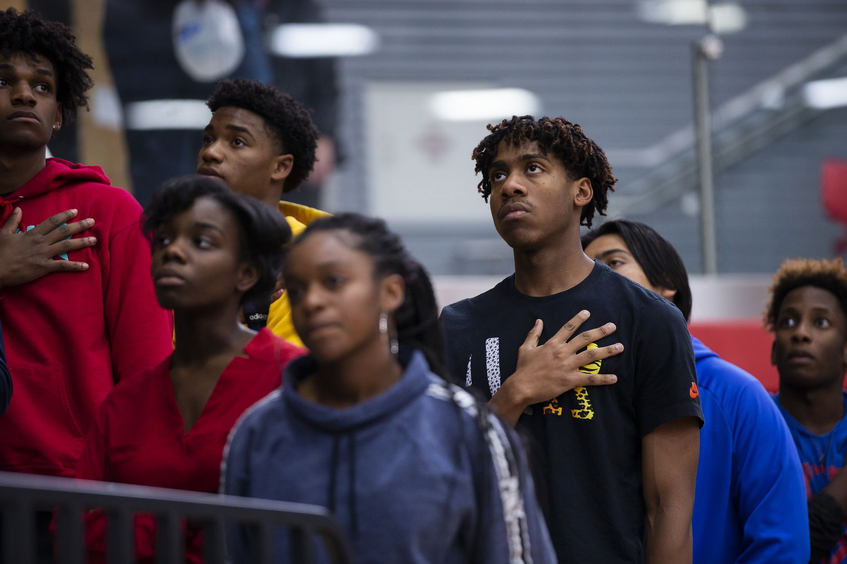 Allen High School junior Devon Chatman, 16, pauses for a moment of silence remembering Marquel Ellis Jr., 16, before a varsity basketball game on Nov. 18, 2019 in Allen. Ellis, a sophomore, was fatally shot at a Plano home late Saturday, according to police and school officials. (Juan Figueroa/ The Dallas Morning News)