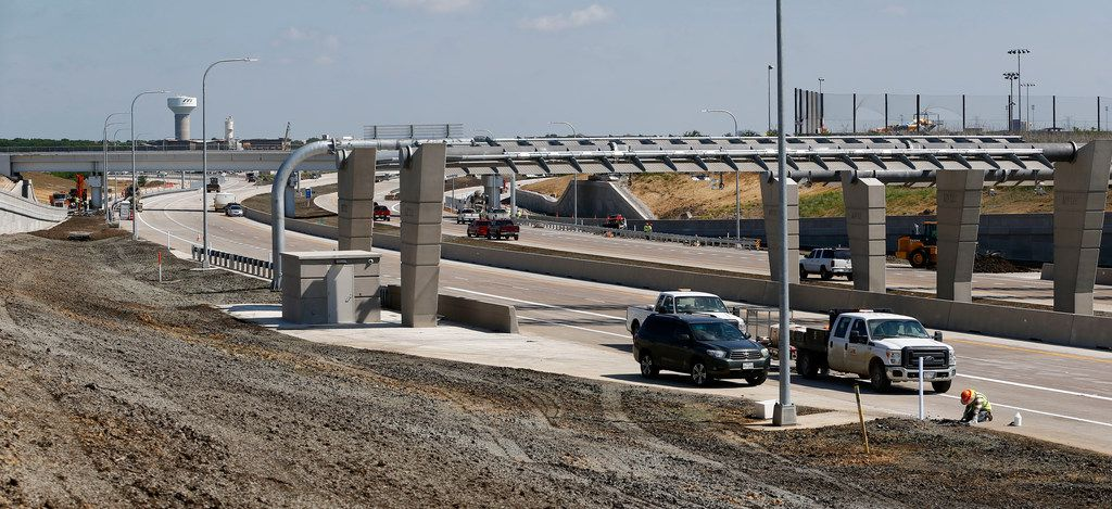 Construction workers put finishing touches on the $300 million 360 Tollway. The 9.7 miles of limited access highway will be open by Saturday morning. (Nathan Hunsinger/The Dallas Morning News)