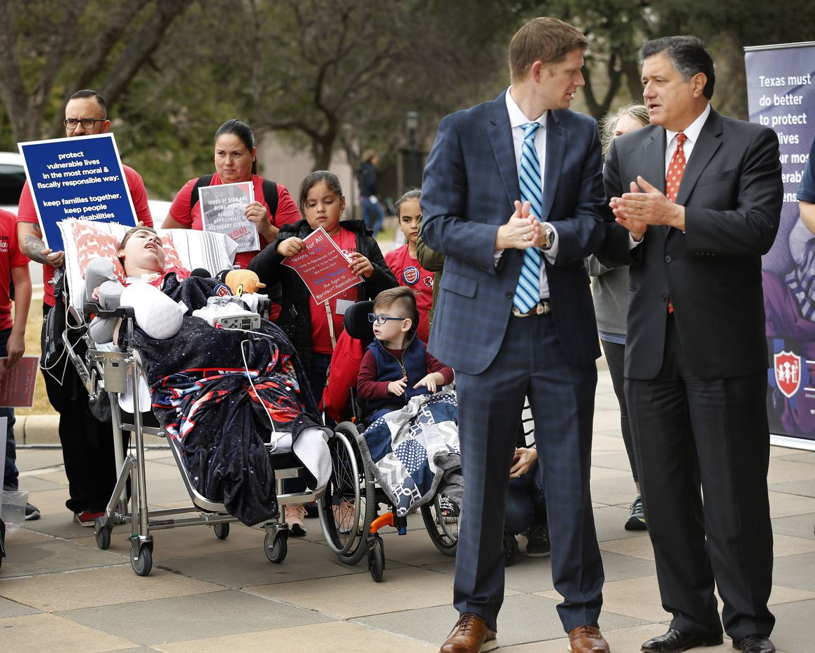 Rep. Richard Raymond D-Laredo (right) and Rep. Matt Krause, R-Tarrant County visit during the Protect Fragile TX Children rally outside the Texas State Capitol, Tuesday, February 26, 2019. Bed-ridden Briar McCann (left), a medically fragile 15 yr-old from Bulverde, Texas,) came to the rally with his mother and caregivers.