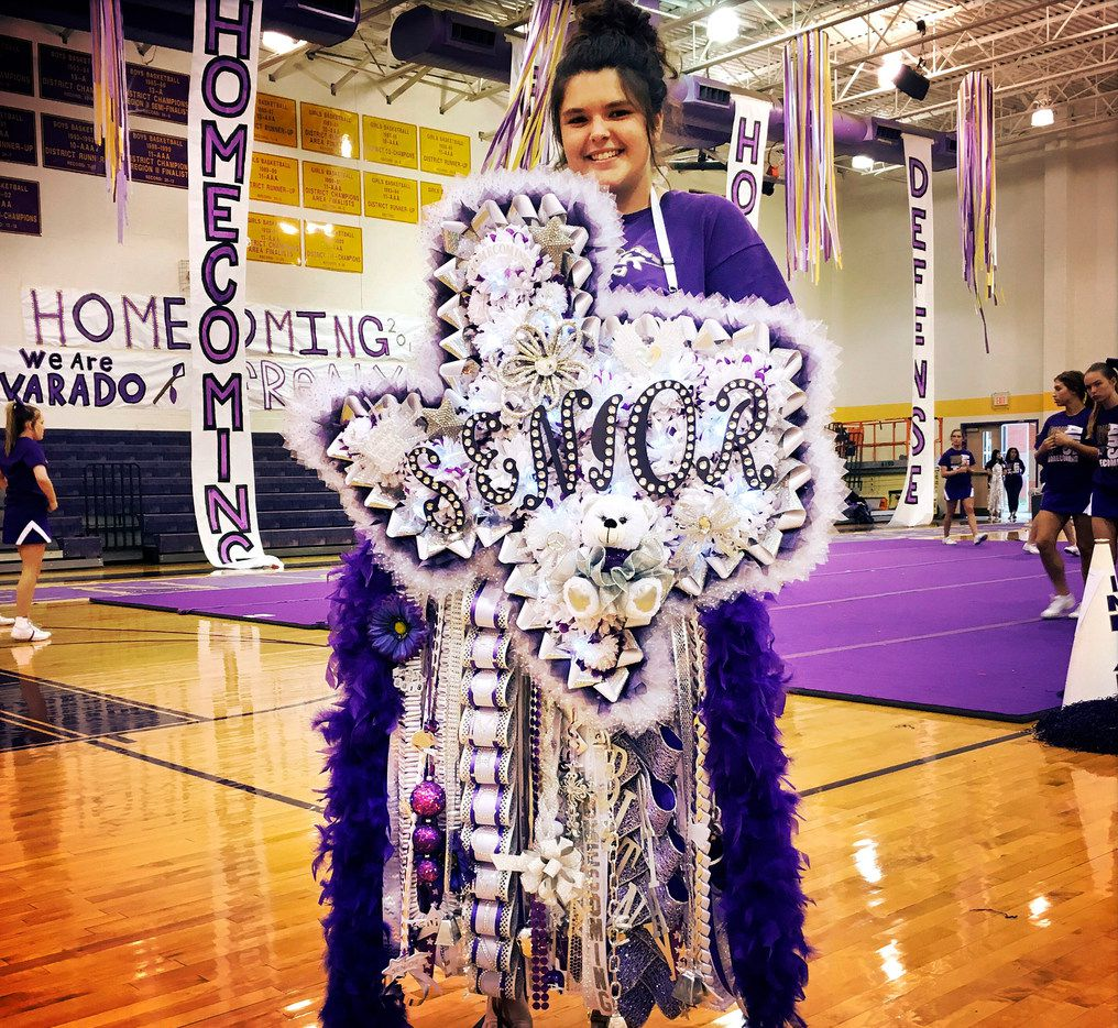 Alvarado High senior Brittany Eicker wore a 'Texas-sized' mum  to their homecoming pep rally, complete with artificial flowers, ribbons, trinkets, and teddy bear,  in Alvarado, Texas, Friday, September 22 2017. (Tom Fox/The Dallas Morning News)