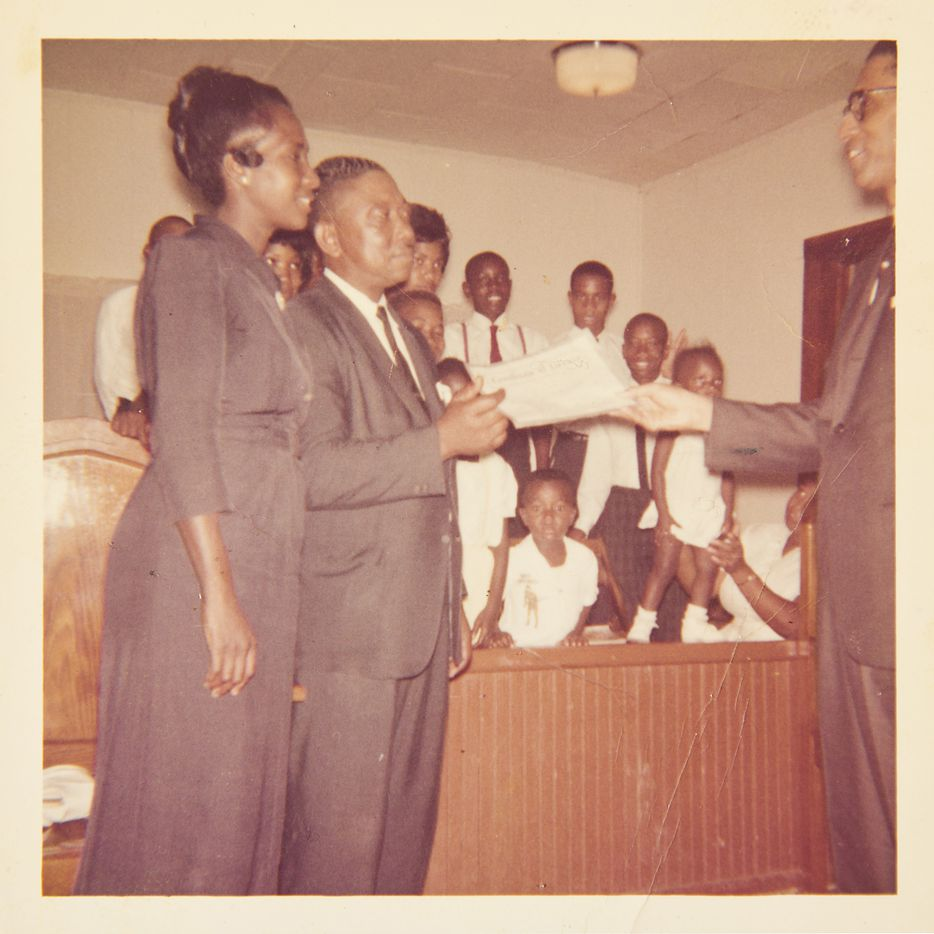 A family photo shows John Wiley Price (background, second from right, just above the hand) with the choir at church when he was a child.