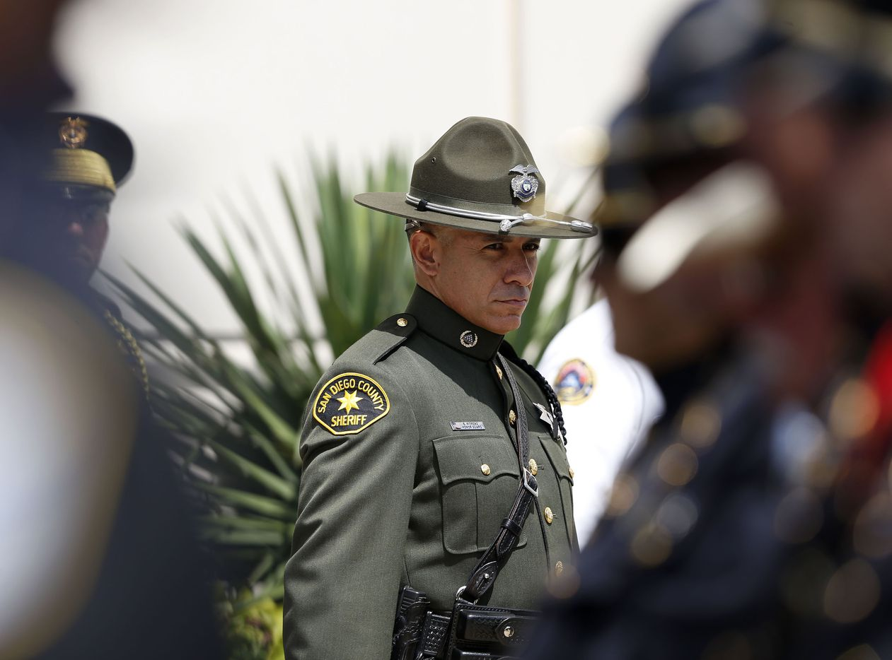 San Diego County Honor Guard member makes his way to through the line during a memorial service for DART Officer Brent Thompson at The Potter's House in Dallas on Wednesday, July 13, 2016. Thompson was one of five officers killed last week when a gunman opened fire during a Black Lives Matter rally in downtown Dallas.