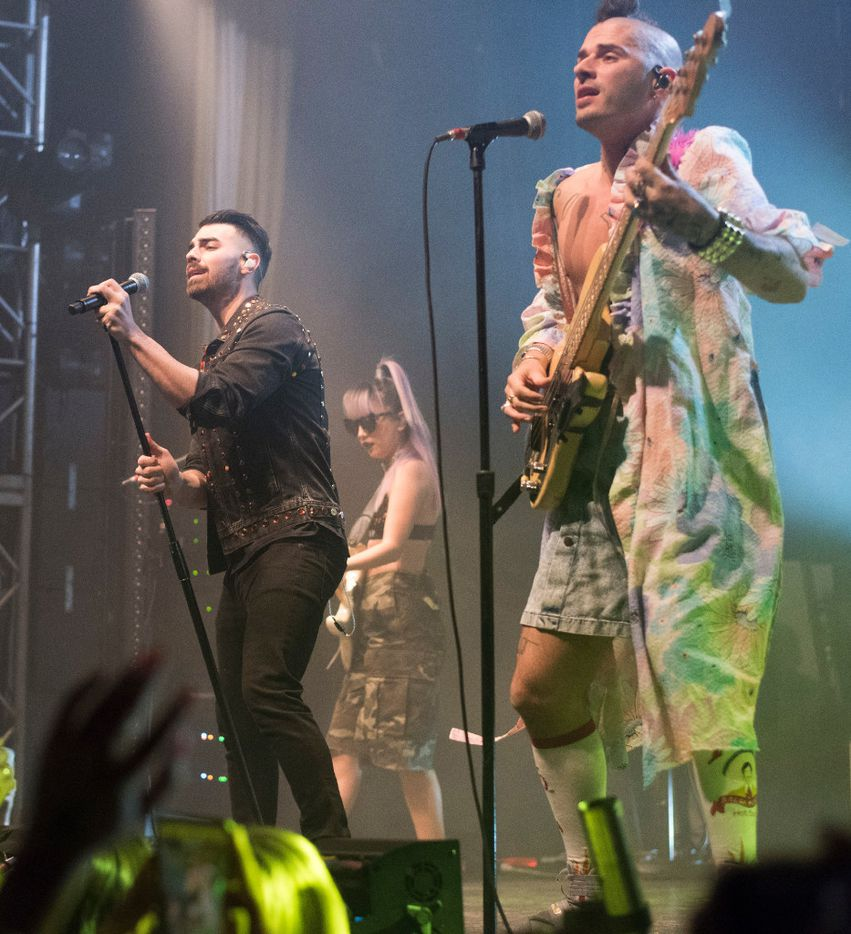 Joe Jonas, left, JinJoo Lee, rear, and Cole Whittle, of the band DNCE, perform at the Granada Theater on Saturday, Jan. 28, 2017.   (Rex C. Curry/Special Contributor)