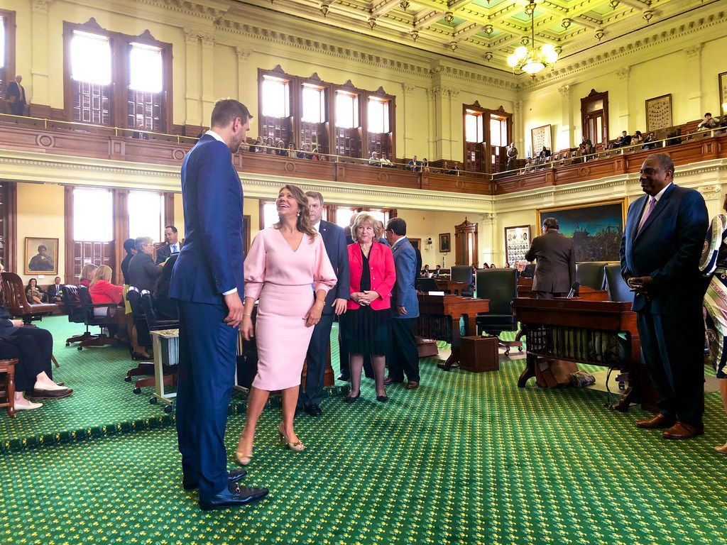 """Mavericks legend Dirk Nowitzki stands before Sen. Joan Huffman, R-Houston, on Tuesday in Austin as Sen. Jane Nelson, R-Flower Mound (center), and Sen. Royce West, D-Dallas (far right), look on. Nowitzki was honored by both chambers of the Texas Legislature and by Gov. Greg Abbott.  West called him a """"a true legend and icon."""""""