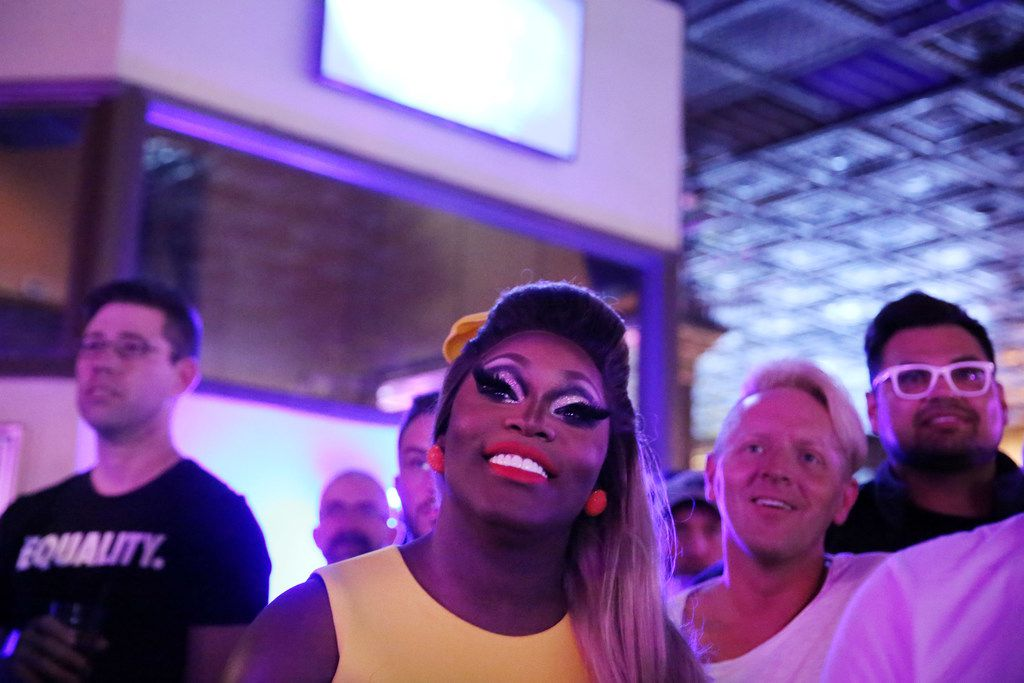 Asia O'Hara watches an episode of 'RuPaul's Drag Race' before speaking with an audience at JR's Bar & Grill during a commercial break in Dallas Thursday April 5, 2018.
