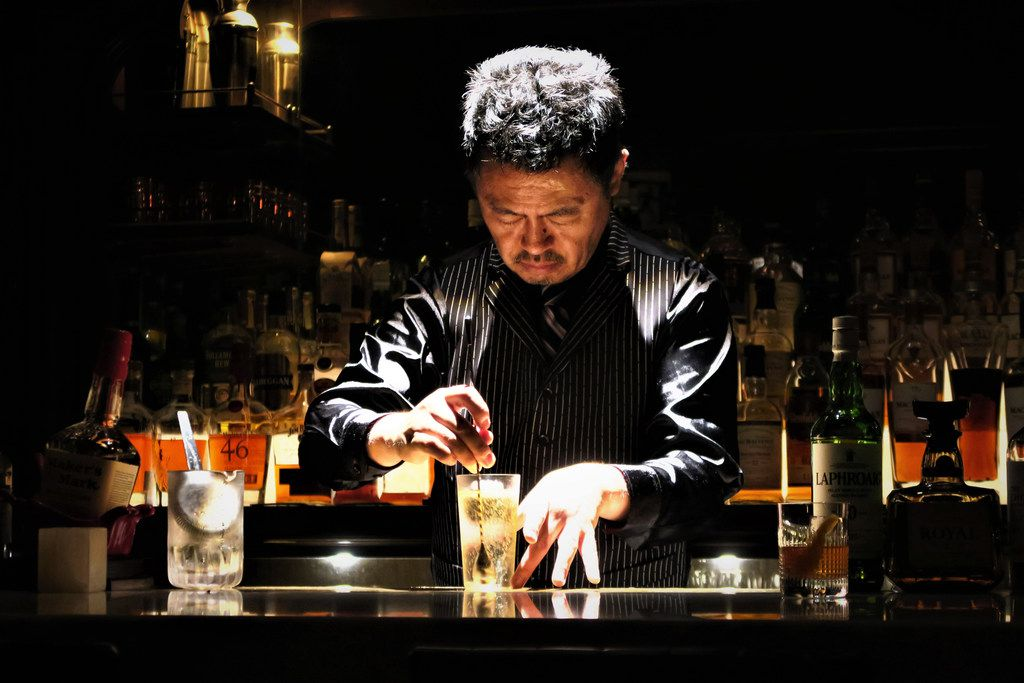 At Apollo Bar in Tokyo, Hidenori Komatsu's highball preparation involves dancelike grace and precision, under a spotlight, with Tom Waits songs playing on repeat.