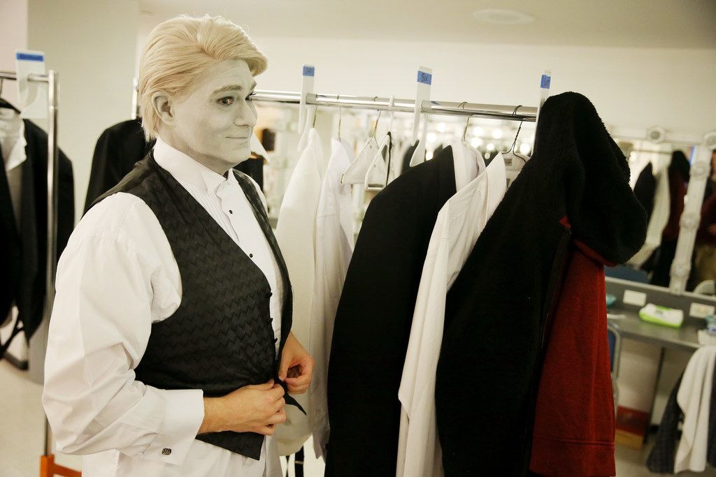 """Makeup finished and wig in place, Ben Bryant dresses for his role in """"A Minor Case of Murder!"""""""