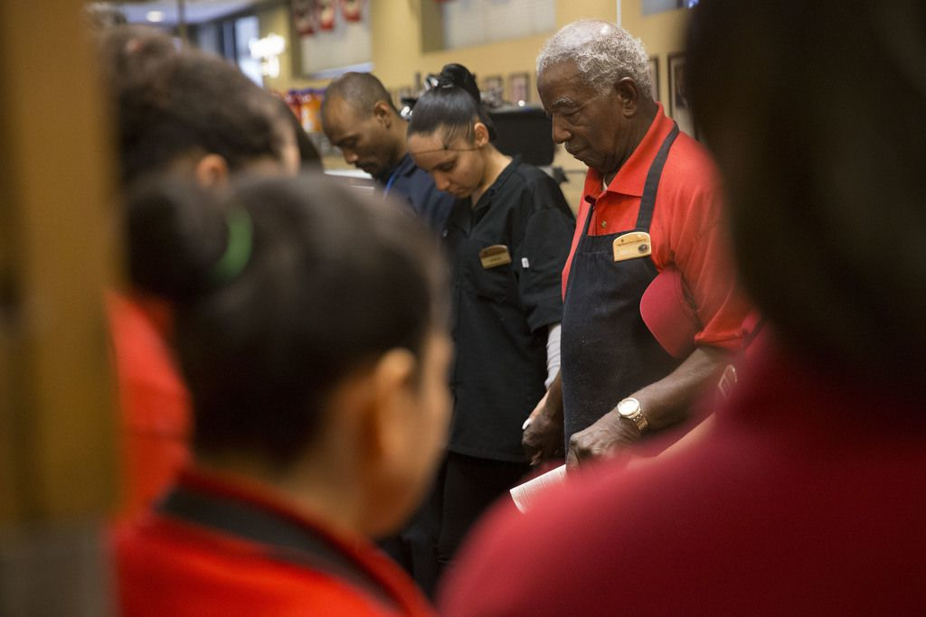 """Ernest """"Mr. B"""" Bowens leads the Highland Park Cafeteria in the daily morning prayer. He's worked for the longtime Dallas restaurant since 1956."""