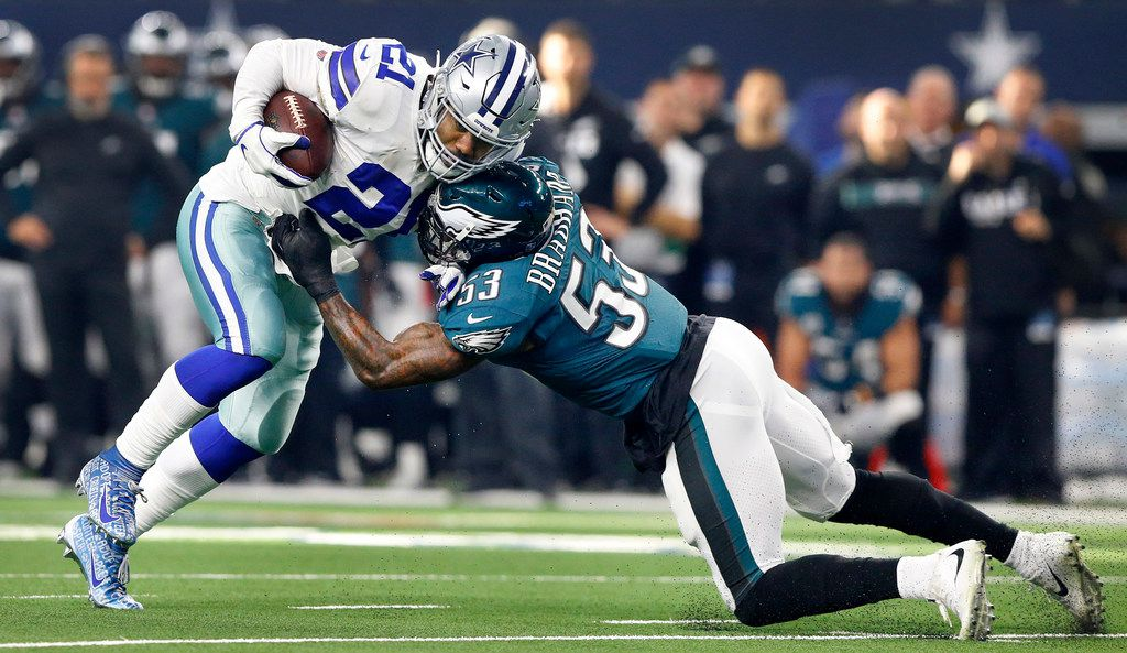 Dallas Cowboys running back Ezekiel Elliott (21) tries to escape the grasp of Philadelphia Eagles outside linebacker Nigel Bradham (53) in the first quarter at AT&T Stadium in Arlington, Texas, Sunday, December 9, 2018. (Tom Fox/The Dallas Morning News)
