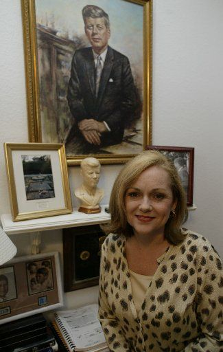 "Debra Conway posed in her Southlake office in 2003. ""It's human nature to create your own scenario than take anything at face value,"" said Conway, a Texas resident and president of JFK Lancer, an assassination research group that gathers annually in Dallas."
