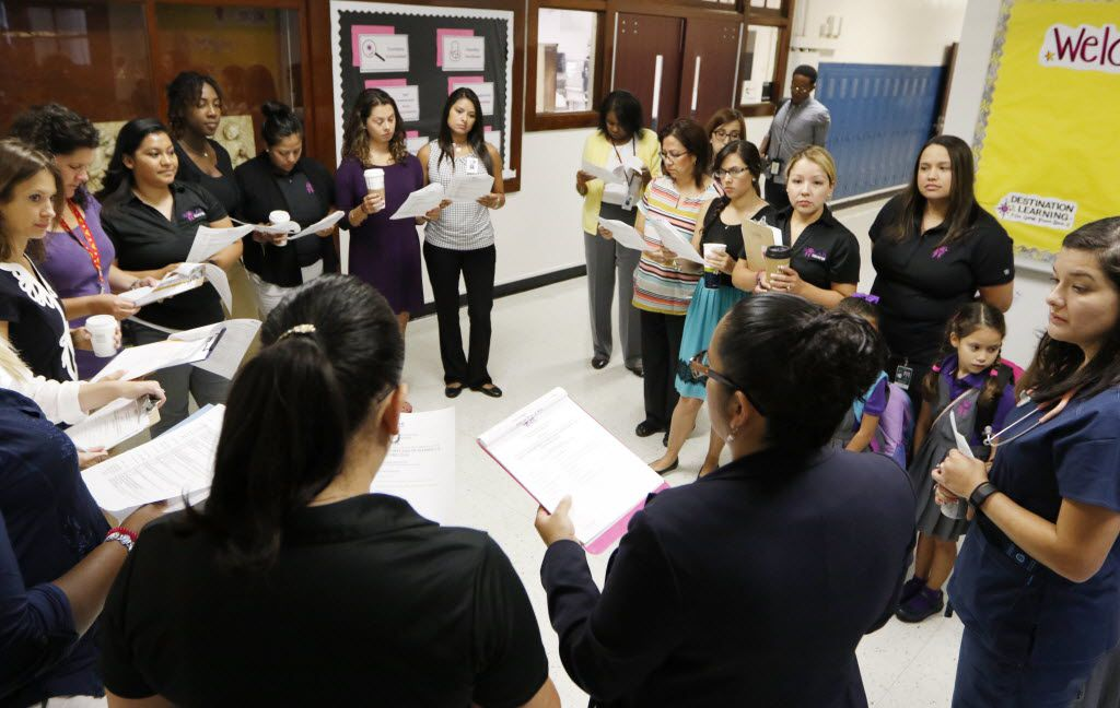 Solar Preparatory School for Girls principal, Nancy Bernardino, foreground, second from right, meets with her staff and teachers before students arrive on the first day of school, Monday, August 22, 2016. The all-girls STEAM (science technology engineering arts and math) academy will eventually go from kindergarten to 8th grade.  Solar Prep is the district's first attempt at a socio-economically balanced campus, with 50 percent of its students qualifying for free and reduced lunch and the other 50 percent who don't. (David Woo/The Dallas Morning News)