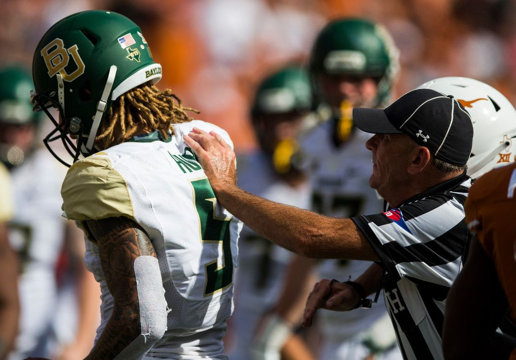 FILE - Baylor wide receiver Jalen Hurd (5) is pushed away by a referee after he got in to an argument with Texas defensive back Kris Boyd (2) during the second quarter of a game on Saturday, Oct. 13, 2018, at Darrell K Royal Memorial Stadium in Austin. (Ashley Landis/The Dallas Morning News)