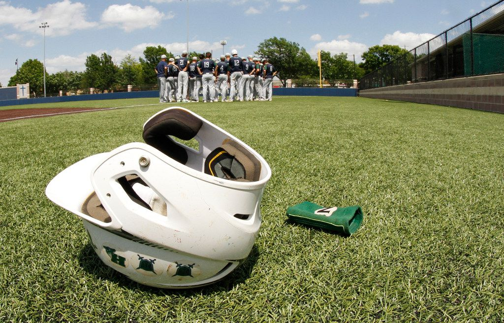 A batting helmet lays on the turf following Frisco Reedy's season ending loss 10-3 in Game 2 to Forney. The two teams played Game 2 of their best-of-3 Class 5A area round baseball playoff  series at  Jesuit High School in Dallas on May 12, 2018. (Steve Hamm/ Special Contributor)