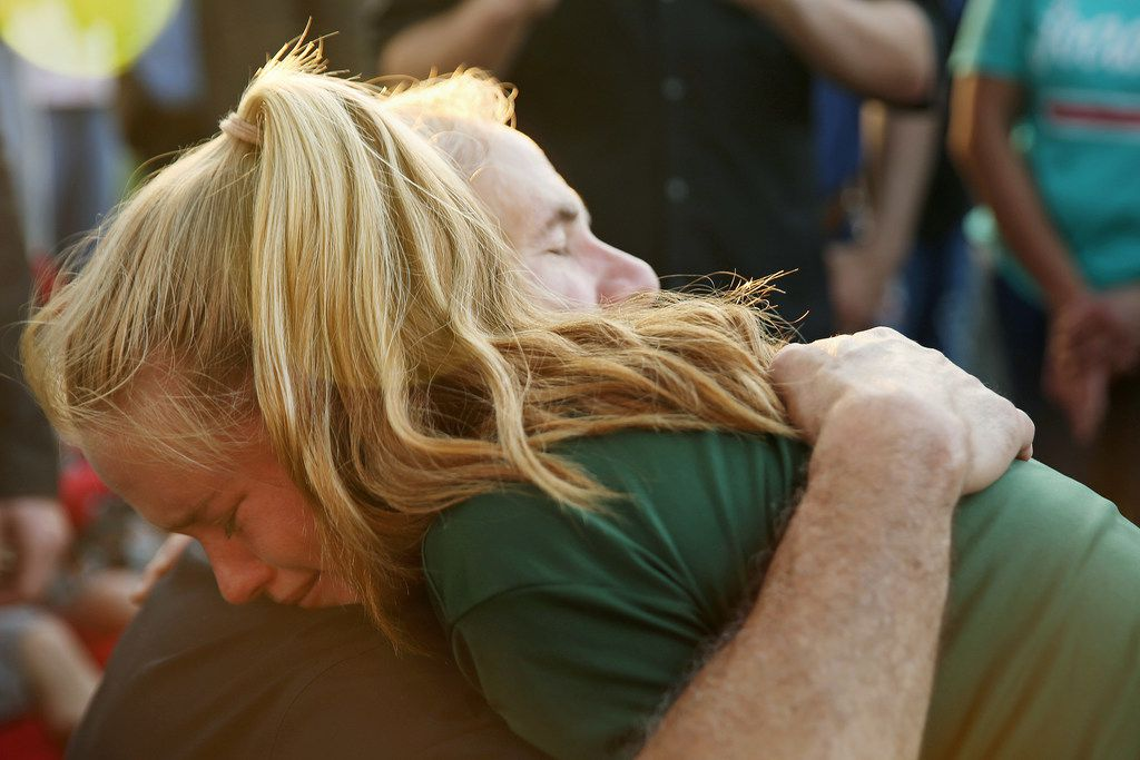Texas governor Greg Abbott hugs Santa Fe High School student Rylie Bouvier, 15, during a vigil following a shooting at Santa Fe High School in Texas on May 18.