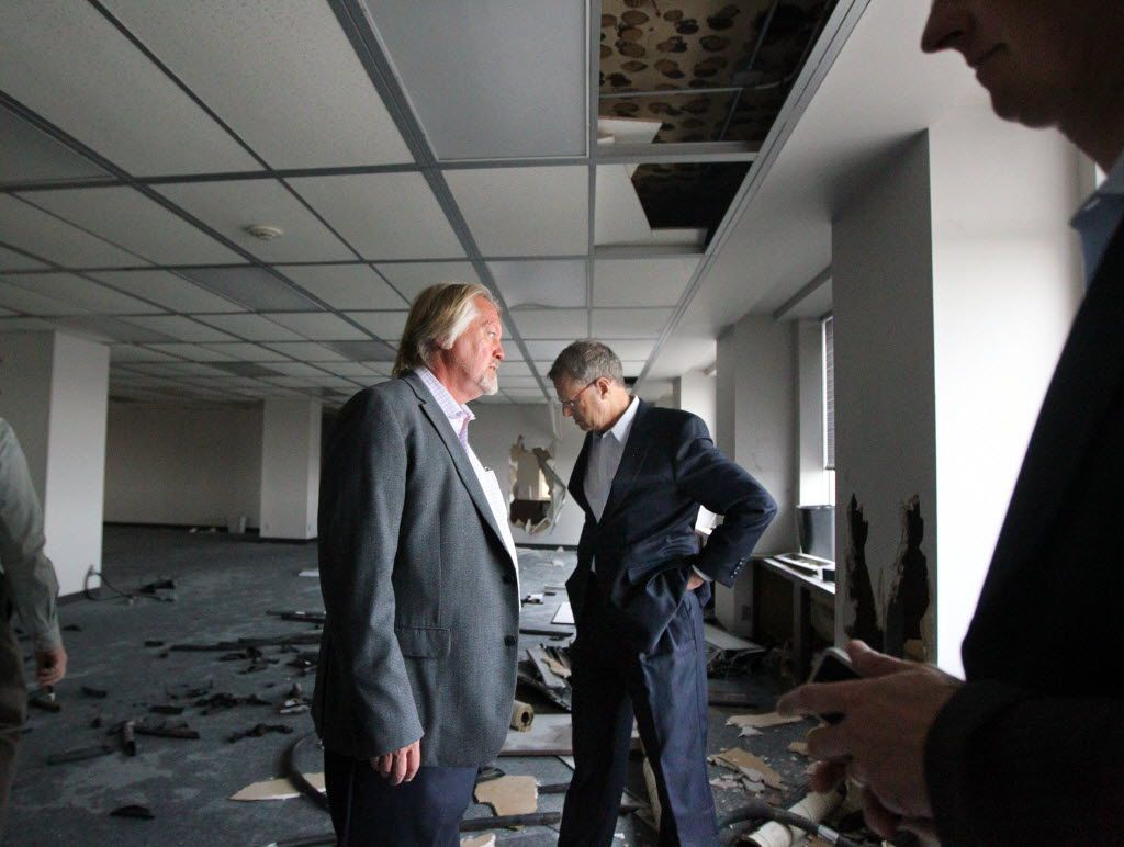 CitySquare's John Greenan, left, and Larry Hamilton toured one of the old Lone Star Gas buildings in downtown Dallas in April 2013.   (Mona Reeder/The Dallas Morning News)