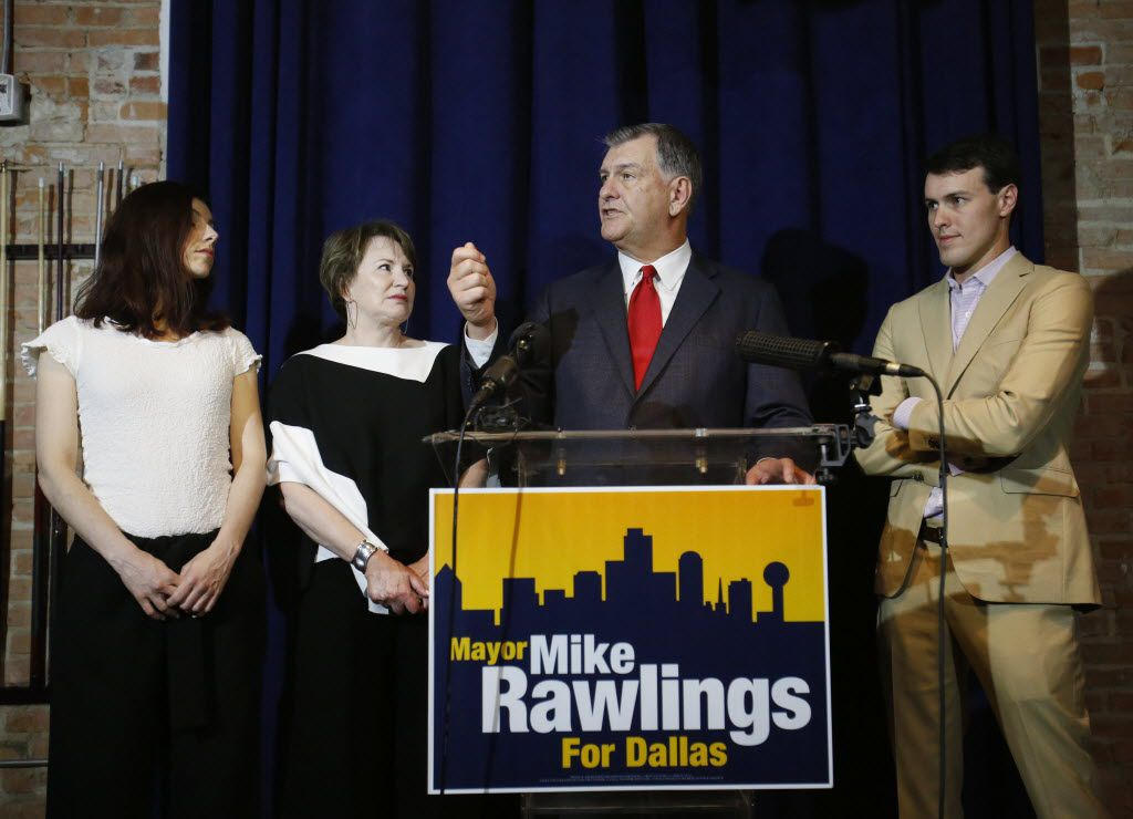 Mayor Mike Rawlings (center) is joined by his wife, Micki Rawlings, daughter Michelle and and son Gunnar Rawlings during his election night party at the NYLO Dallas South Side on May 9, 2015.