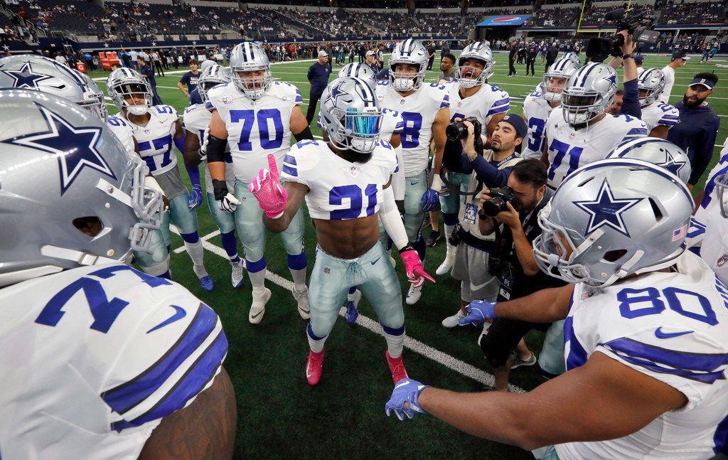 Dallas Cowboys running back Ezekiel Elliott (21) gets his teammates fired up before facing the Jacksonville Jaguars at AT&T Stadium in Arlington, Texas, Sunday, October 14, 2018. (Tom Fox/The Dallas Morning News)