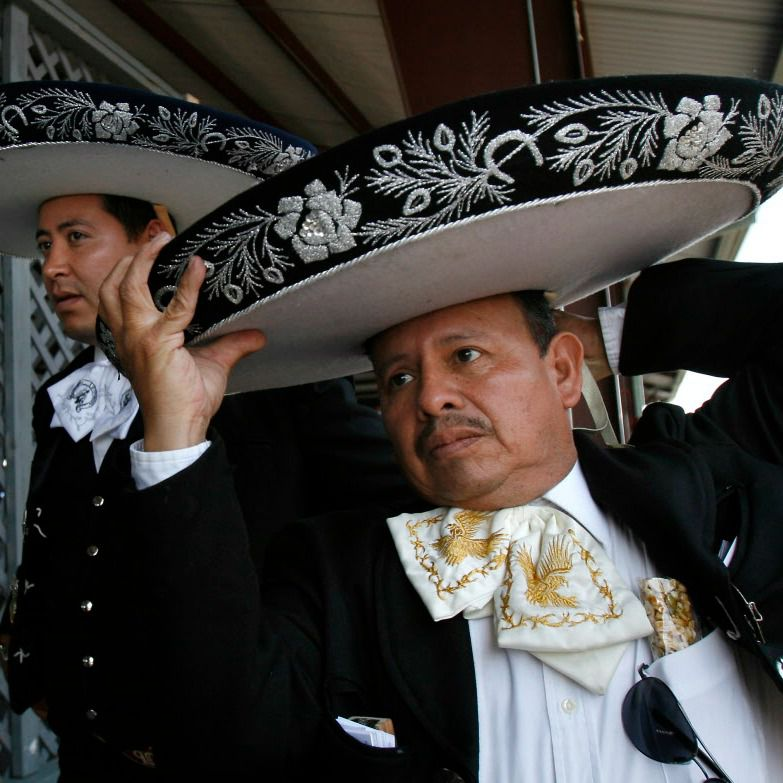 Serafien Salas of Mariachi 90 adjusts his sombrero before going on stage.