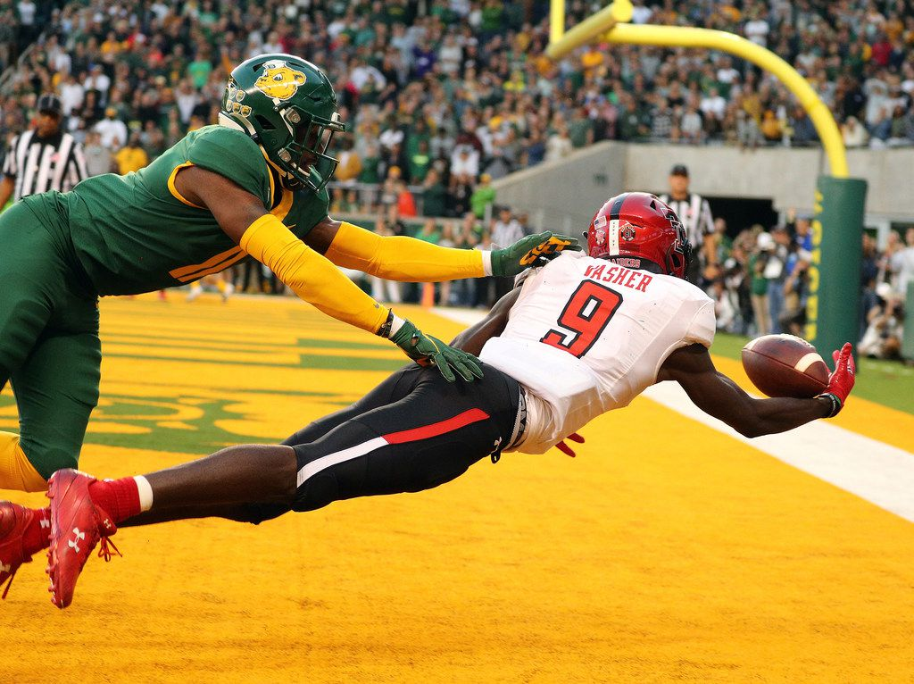 WACO, TEXAS - OCTOBER 12: T.J. Vasher #9 of the Texas Tech Red Raiders makes a touchdown reception against Jameson Houston #11 of the Baylor Bears in overtime on October 12, 2019 in Waco, Texas.