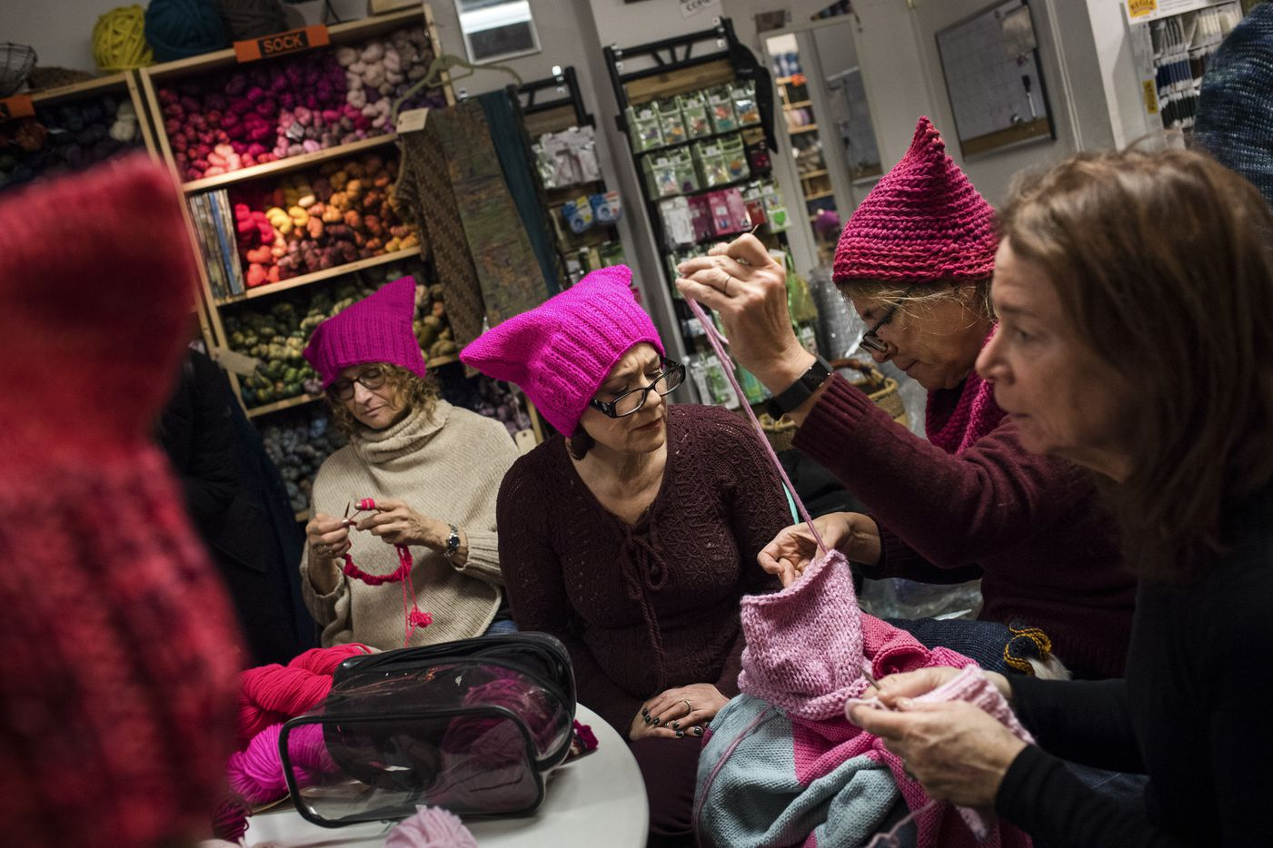 Knitters involved in the Pussyhat Project, a response to President Donald Trump's election campaign comments, at Knitty City in New York, Jan. 10, 2017. Throughout the city, individuals and groups concerned about today's political climate donated their time, talent and passion to support the Women's March on Washington and other events across the country.