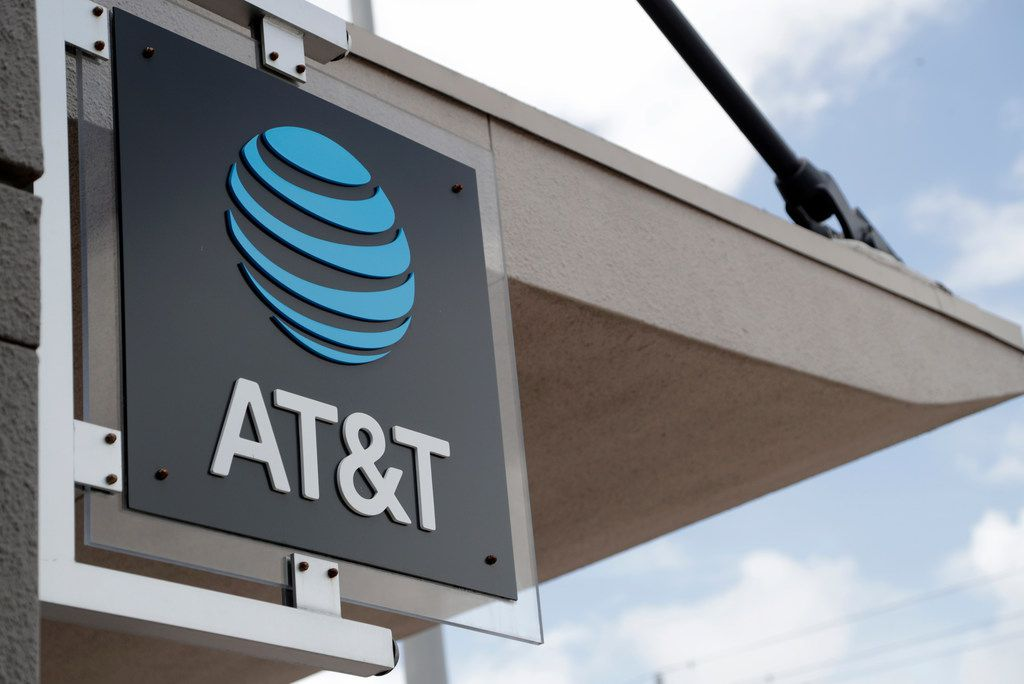 In this July 18, 2019, file photo, a sign is displayed at an AT&T retail store in Miami. Activist hedge fund manager Elliott Management is making a new $3.2 billion investment in AT&T, saying the company could be valued at more than $60 a share by 2021's end. AT&T stock jumped nearly 6% to $38.31 in Monday, Sept. 9, premarket trading.