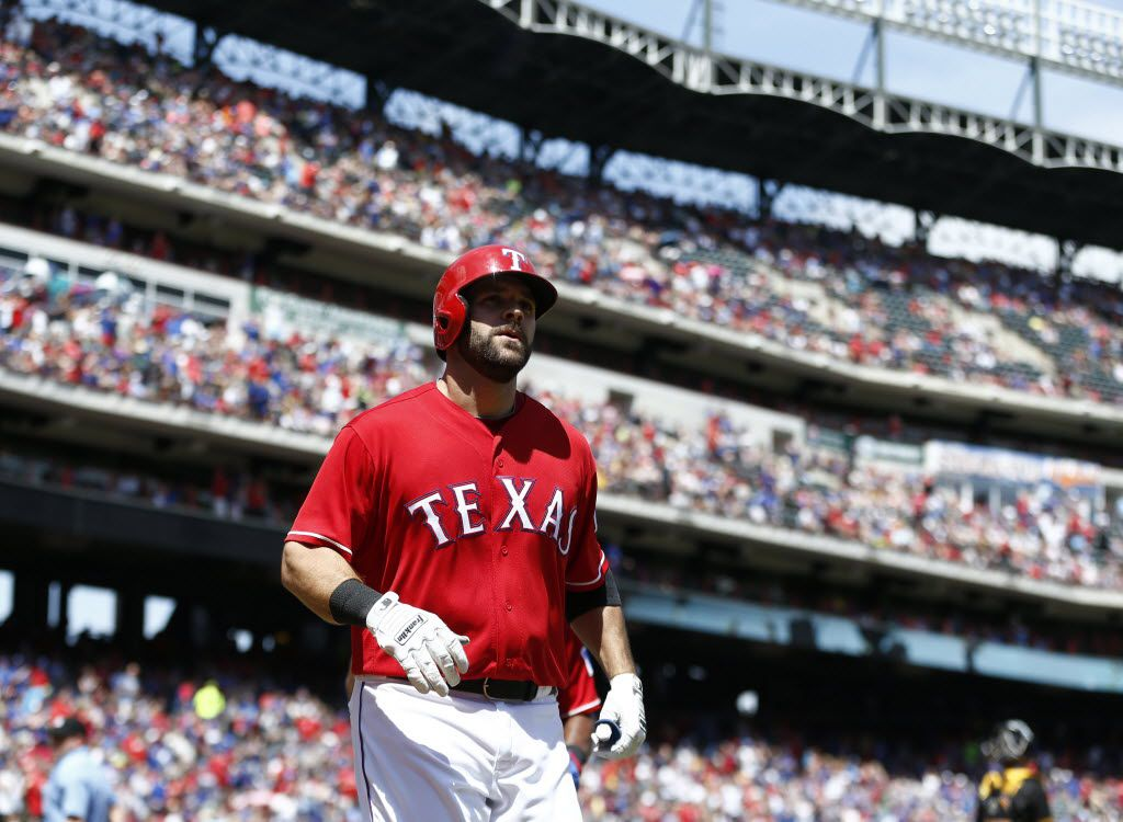 Texas Rangers first baseman Mitch Moreland (18) runs to the dugout after hitting a home run against  Pittsburgh Pirates during their game at Globe Life Park in Arlington, Texas  May 29, 2016.  (Nathan Hunsinger/The Dallas Morning News)