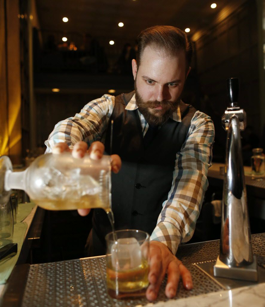 Here's Hartai in 2015 making the Signet:  scotch, chartreuse and creme de cacao poured over a hand-cut ice cube.