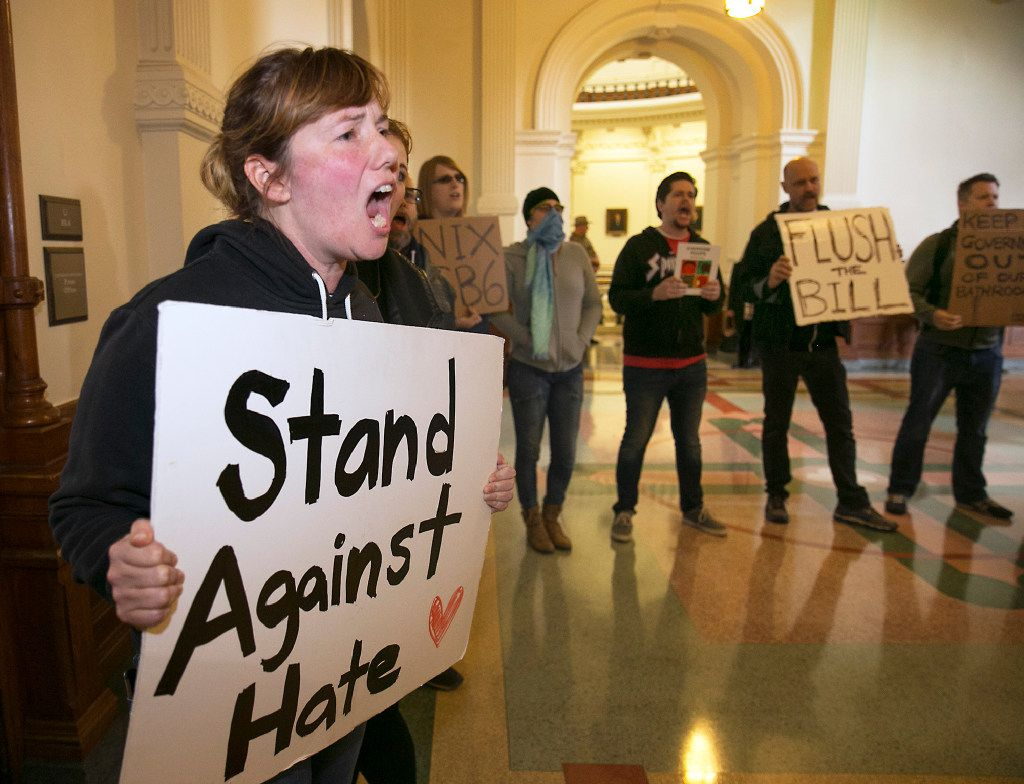 Protester Katie Graham tried to drown out a news conference with Lt. Gov. Dan Patrick and Sen. Lois Kolkhorst, R-Brenham, as they introduced Senate Bill 6 at the Texas Capitol on Jan. 9. (Ralph Barrera/Austin American-Statesman)