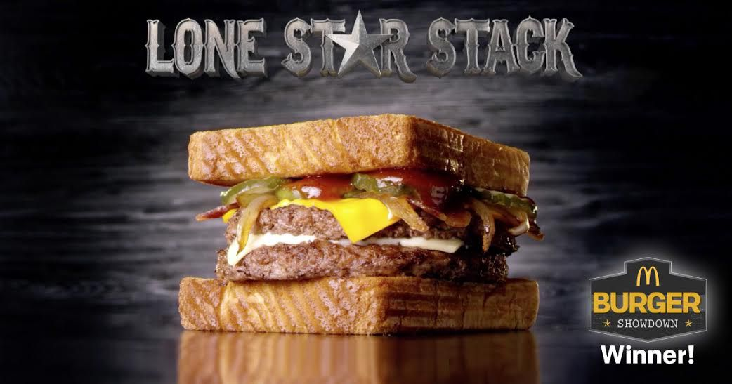 McDonald's Lone Star Stack is made of two 100% beef patties, Applewood bacon, American and white cheddar cheeses, sweet onion BBQ sauce, crinkle pickles and grilled onions stacked between two slices of Texas toast.