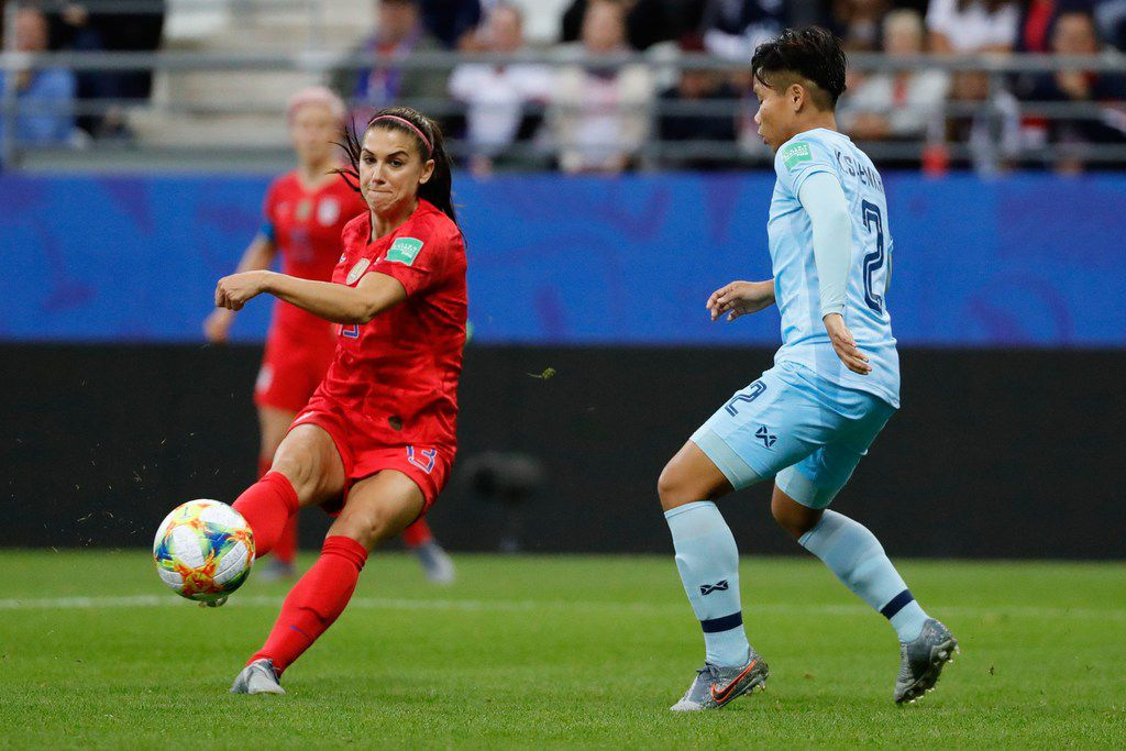 United States' forward Alex Morgan (L) vies for the ball with Thailand's defender Kanjanaporn Saenkhun during the France 2019 Women's World Cup Group F football match between USA and Thailand, on June 11, 2019, at the Auguste-Delaune Stadium in Reims, eastern France. (Photo by Thomas SAMSON / AFP)THOMAS SAMSON/AFP/Getty Images