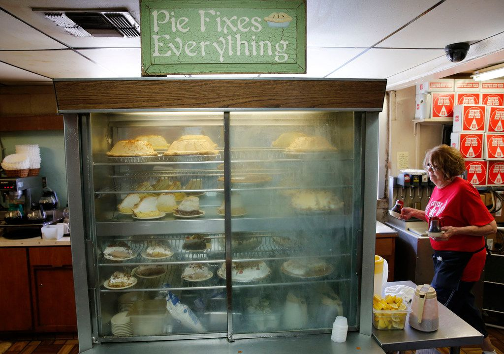 "A sign on top of a refrigerator says ""pie fixes everything,"" near the checkout counter at Koffee Kup Family Restaurant in Hico, Texas on Friday, March 16, 2018."