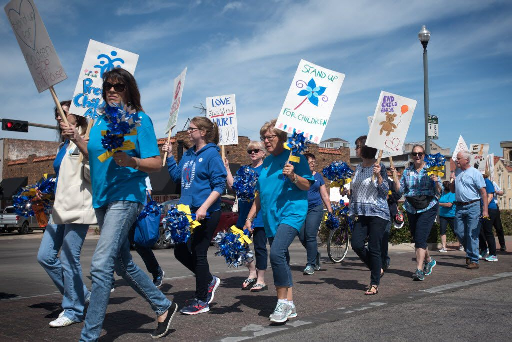 Court Appointed Special Advocates of Denton County marched from the Denton Civic Center to the Denton Square to help spread awareness of the effects of child abuse.   April is National Child Abuse Prevention Month.