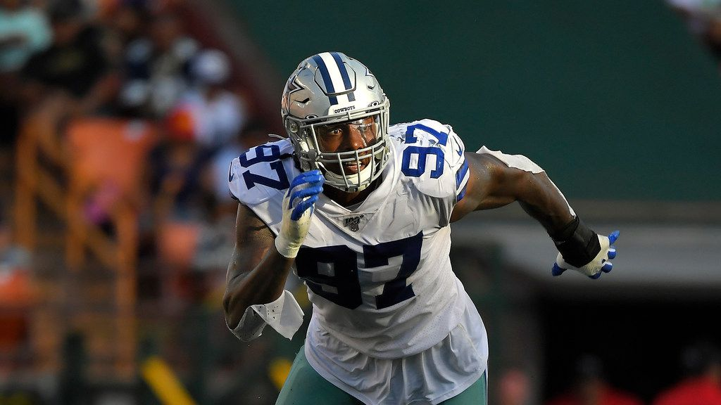 Dallas Cowboys defensive end Taco Charlton runs a play during the first half of a preseason NFL football game against the Los Angeles Rams Saturday, Aug. 17, 2019, in Honolulu. (AP Photo/Mark J. Terrill)