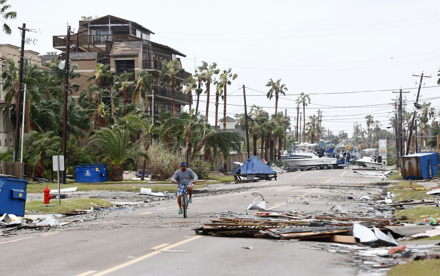 Mike Andrews rides his bike down the street after Hurricane Harvey hit Port Aransas, Texas on Aug. 26, 2017.