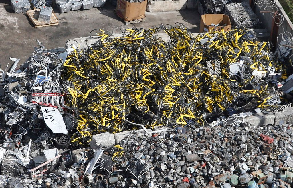 Hundreds of yellow Ofo rental bikes that once populated downtown Dallas sidewalks are now in a heap at CMC Recycling's facility on Good Latimer Expressway.