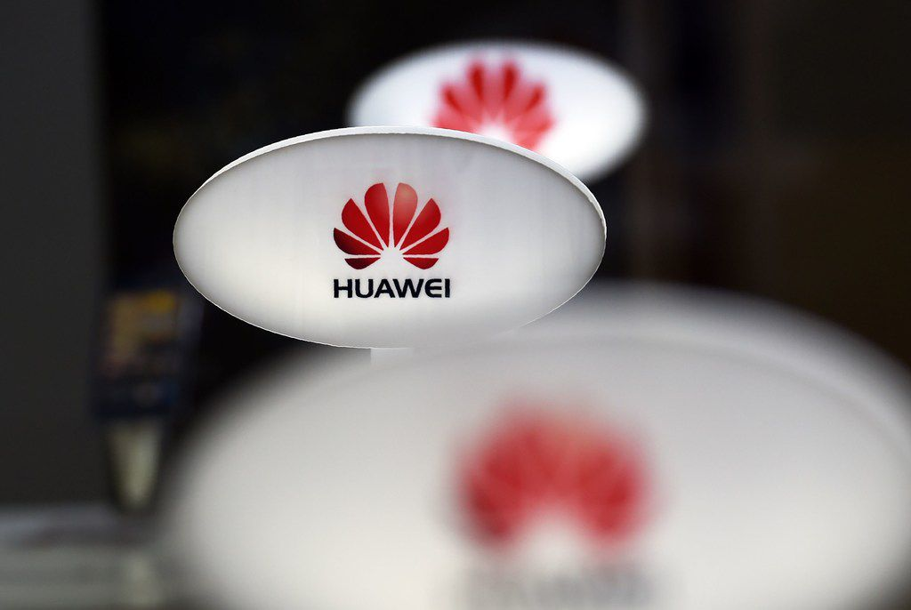 This file picture taken on August 3, 2015, shows signs for Chinese telecom equipment maker Huawei displayed in a store selling mobile phones in Beijing. The telecom giant has its North American headquarters in Plano.  GREG BAKERGREG BAKER/AFP/Getty Images