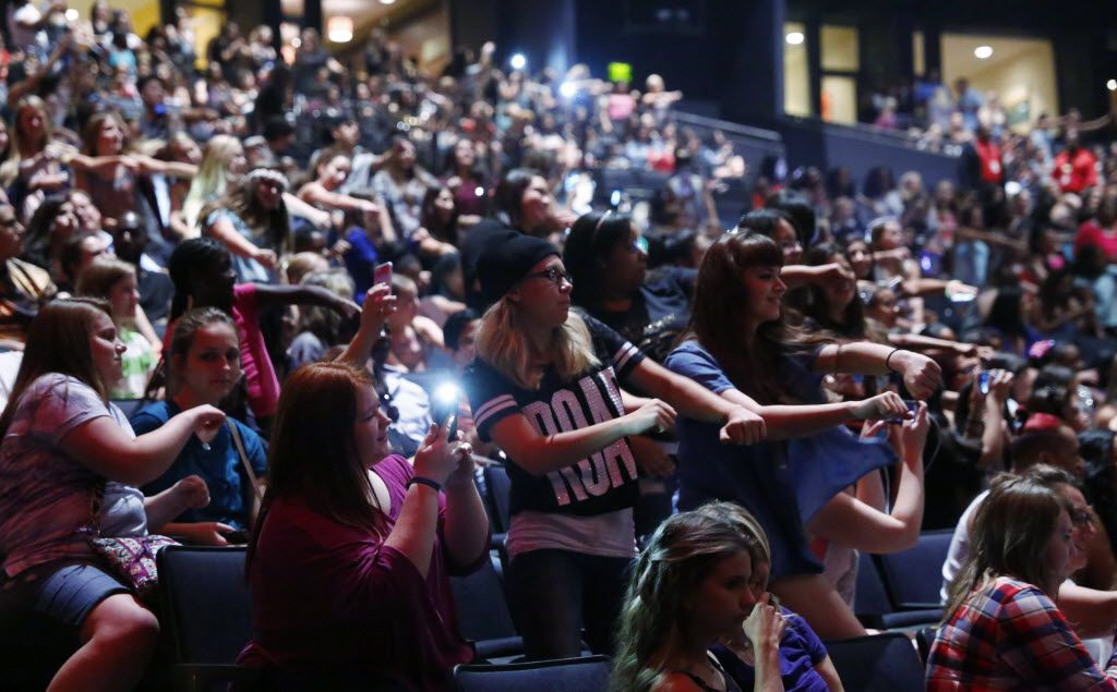 Fans danced to the music before a Fifth Harmony concert at Verizon Theatre in Grand Prairie.