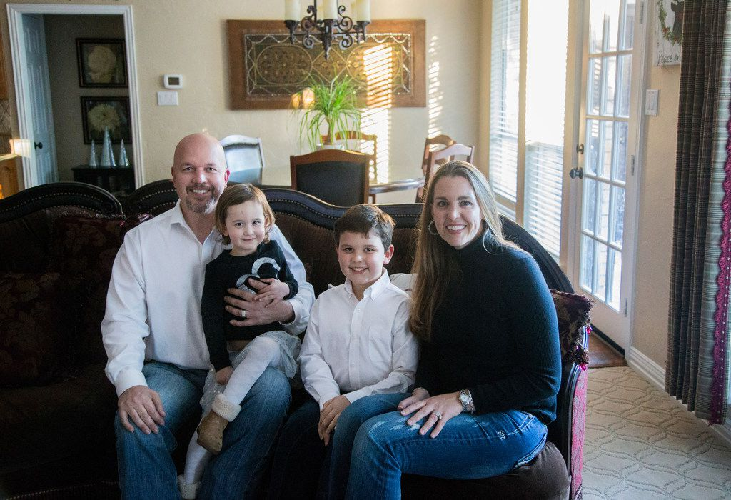 From left, Raun, Alexis, 3, Benjamin, 8, and Meredith Greenstreet of Flower Mound at their home on Nov. 14, 2018. Meredith Greenstreet was diagnosed with lymphoblastic lymphoma less than a year after giving birth to Benjamin. Against steep odds, she got pregnant with Alexis after going through chemotherapy for several years.