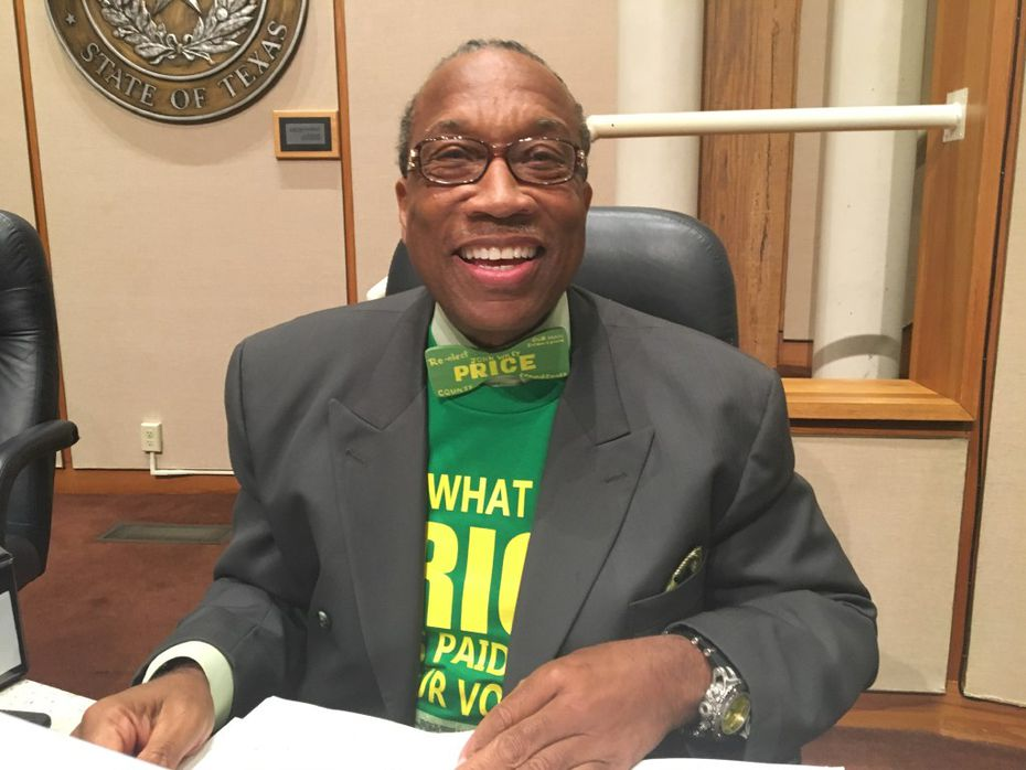 """Dallas County Commissioner John Wiley Price, wearing one of his signature bowties that reads """"Re-elect Price, Our man downtown"""" at a commissioners court meeting in October."""
