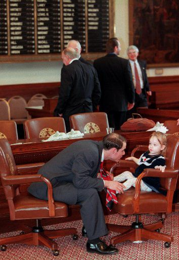 Dennis Bonnen, as a 24-year-old  freshmen state representative, played with his niece, Lindsay Bonnen, 2, after being sworn into office in 1997. His family did not arrive to see him  sworn in, but instead came at the close of the opening day session. They were  delayed by the icy road conditions.